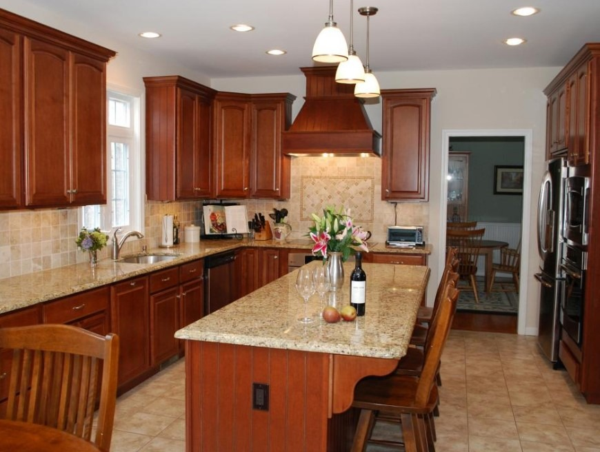 Wooden Cabinets With White Granite Kitchen Countertops Designs