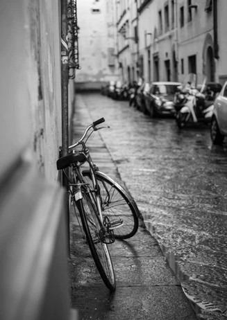 ORNELLA BINNI - bike on rainy street
