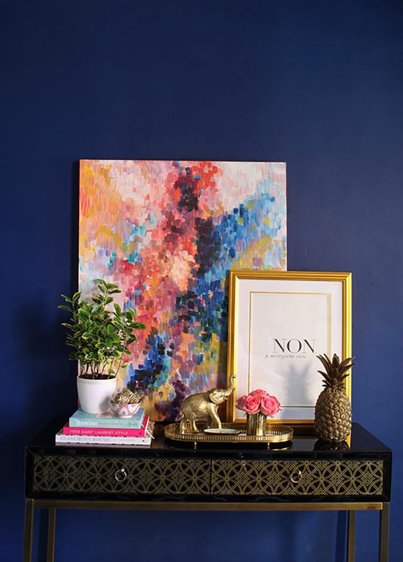 Be Bold with a Unique Color of Walls and a Statement Pieace of Art