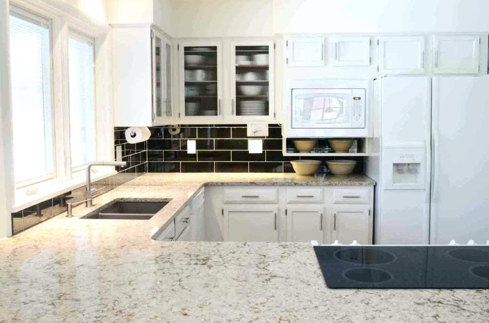 Modern Kitchen with White Granite Countertop
